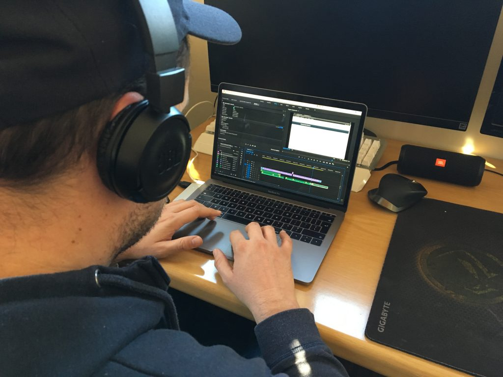 Travis Lima working on a video editing.